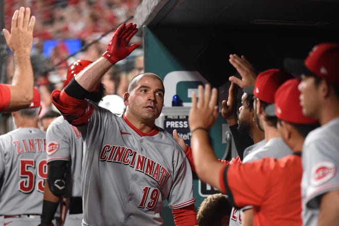 Cincinnati Reds first baseman Joey Votto (19) is congratulated after hitting a solo home-run against the St. Louis Cardinals during the fourth inning at Busch Stadium on Sept. 10.