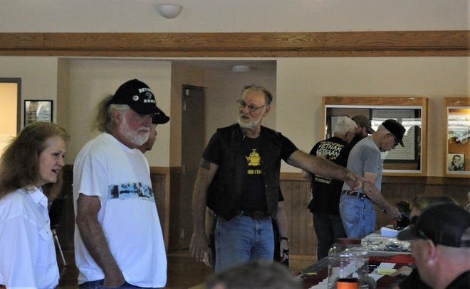 Tom Dile (black shirt) talks to a fellow veteran during 9-11 Appreciation Day on Saturday at the Lake Park Pavilion. Dile served in the Army for 20 years.