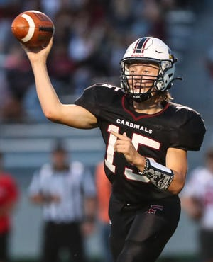 Fond du Lac quarterback Connor Klapperich throws a pass against Neenah during Friday's game at Fruth Field in Fond du Lac.