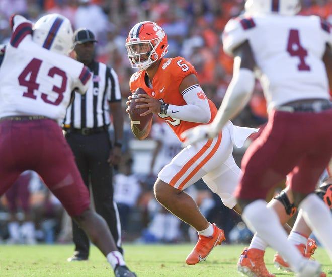 Clemson quarterback D.J. Uiagalelei (5) rolls out to pass during the second quarter Sep 11, 2021; Clemson, South Carolina, USA;  at Memorial Stadium.