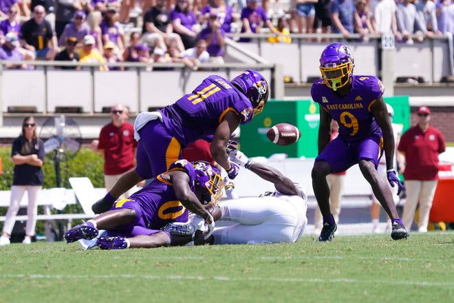 South Carolina wide receiver Dakereon Joyner (5) fumbles the ball after his catch against East Carolina as the Pirates' Jeremy Lewis (11), Jireh Wilson (0) and D.J. Ford (9) close in for the recovery during the first half at Dowdy-Ficklen Stadium on Saturday. James Guillory-USA TODAY Sports