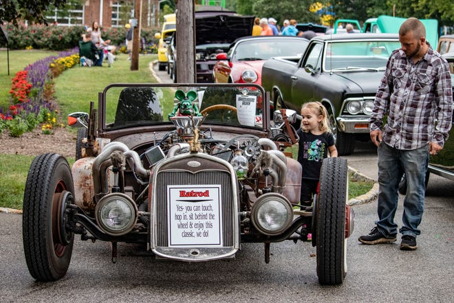 Labor Day Weekend Free Family Day attendees look at a car Sept. 4, 2021, at Columbian Park in Lafayette, Ind.