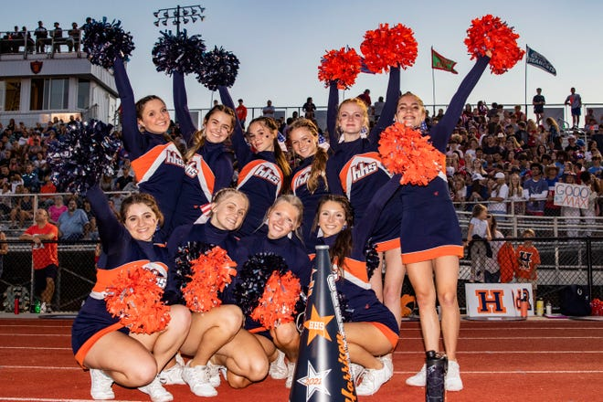 Harrison's cheer squad smiles in front of the student section Friday, Sept. 10, 2021, in West Lafayette.