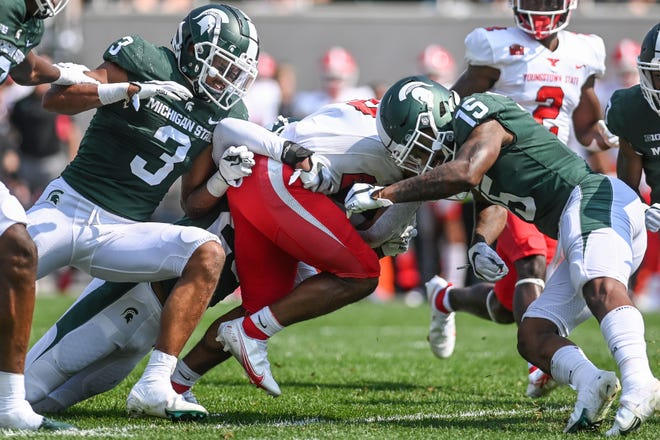 Michigan State's Xavier Henderson, left, and Angelo Grose, right, tackle Youngstown State's Natavious Payne during the second quarter on Saturday, Sept. 11, 2021, at Spartan Stadium in East Lansing.