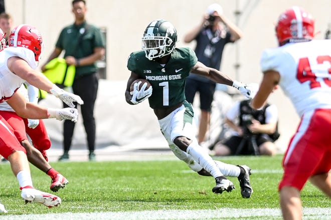 Michigan State's Jayden Reed gains positive yards on a kickoff return against Youngstown State during the third quarter on Saturday, Sept. 11, 2021, at Spartan Stadium in East Lansing.
