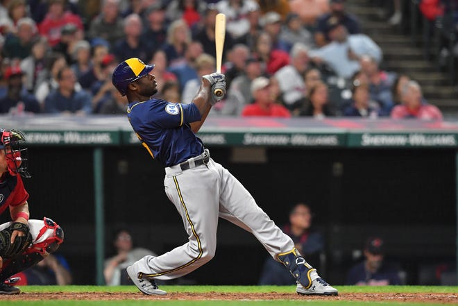 Lorenzo Cain  hits a grand slam to left field during the fifth inning Friday night in Cleveland.