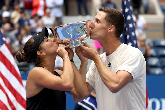Desirae Krawczyk and Joe Salisbury celebrate with the US Open mixed doubles championship trophy at the 2021 US Open at the USTA Billie Jean King National Tennis Center in New York City on September 11, 2021.