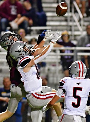 South Western's Max Wisensale, front, breaks up a pass meant for New Oxford's Hunter Crabbs during football action at New Oxford High School in Oxford Township, Friday, Sept. 10, 2021. South Western would win the game 14-7. Dawn J. Sagert photo