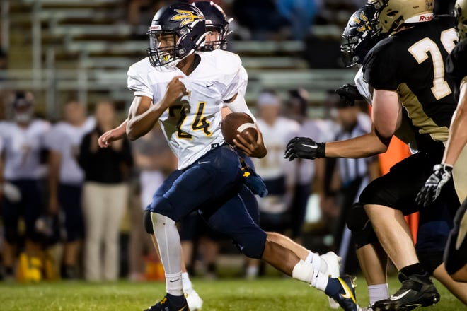 Greencastle-Antrim's Tavon Cooper takes off on a 53-yard run to score a touchdown in the fourth quarter against Delone Catholic at J.T. Flaherty Field on Friday, Sept. 10, 2021 in McSherrystown.