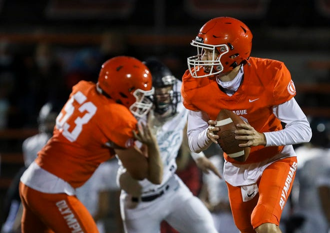 Sprague's Logan Smith (8) looks to make a pass during the game against Century on Friday, Sept. 10, 2021 at Sprague High School in Salem.