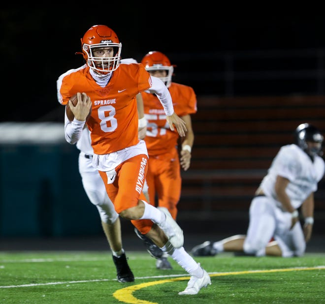 Sprague's Logan Smith (8) carries the ball during the game against Century on Friday, Sept. 10, 2021 at Sprague High School in Salem, Ore.