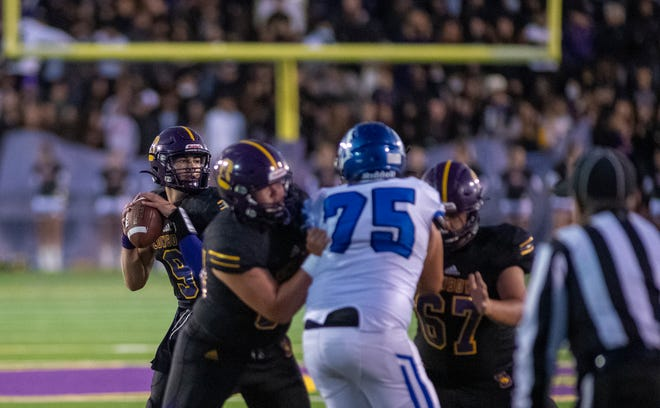 Adam Shaffer Jr, #9, Salinas High School's varsity quarterback prepares to throw the football during his first home game of the season in Salinas, Calif., on Friday, Sep. 10, 2021.