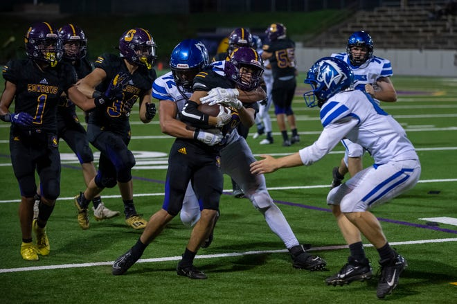 A Salinas High School varsity football player is tackled by a Monte Vista Christian School player in Salinas, Calif., on Friday, Sep. 10, 2021.