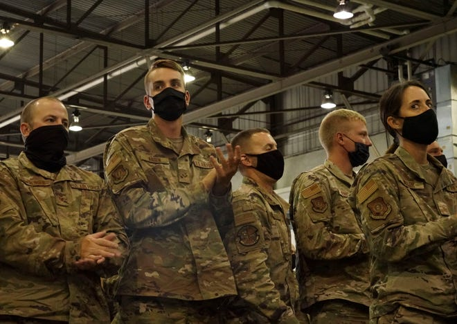 Airmen belonging to the 114th Fighter Wing division of the South Dakota National Guard clapping as Governor Kristi Noem is introduced. The 114th Fighter Wing was welcomed home on Saturday, Sept. 11, 2021 after their deployment.