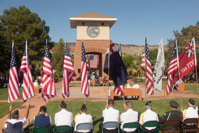 """Community members gather at Town Square Park for the """"Remembering 9-11: Honoring First Responders and Their Families"""" event on Saturday."""