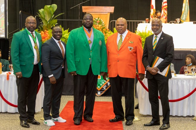 """From left to right: FAMU National Alumni Association President Col. Greg Clark, FAMU VP/Director of Athletics Kortne Gosha, FAMU Sports Hall of Fame inductee Quinn Gray, Rattler """"F"""" Club President Curtis Taylor and FAMU President Larry Robinson celebrate during the induction ceremony on Friday, Sept. 10, 2021."""