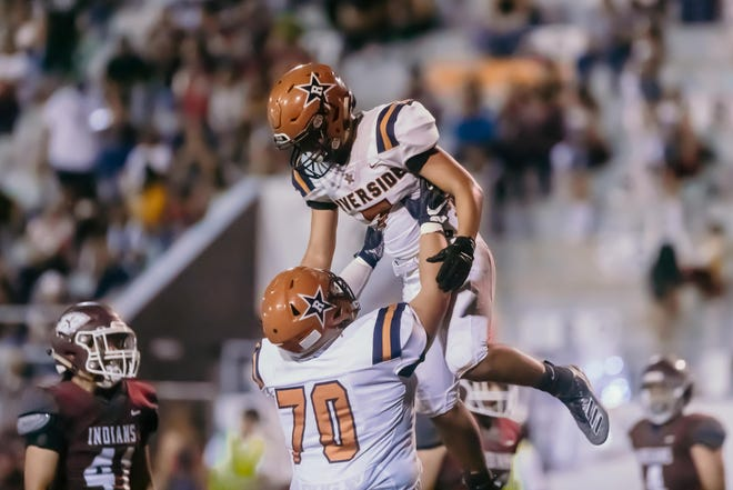 Riverside celebrates at a football game against Riverside High School at Ysleta High School in El Paso, Texas on Friday, Sept. 2021.