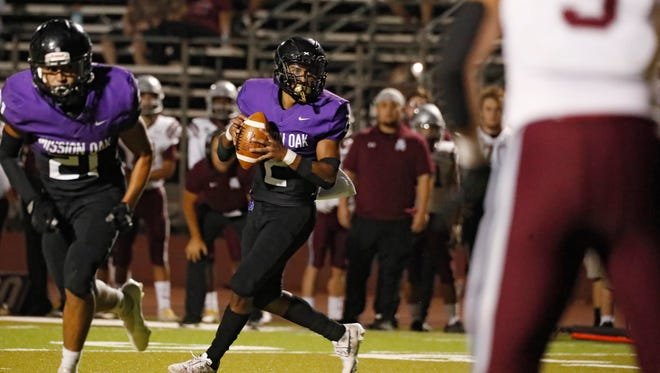 Mission Oak's Michael Iriye looks to pass against Mount Whitney in a high school football game in Tulare, Calif., Friday, Sept. 10, 2021.