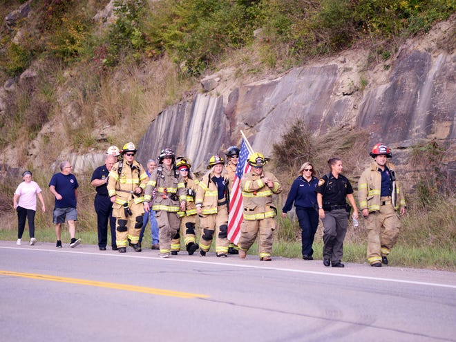 First responders from Muskingum and surrounding counties participate in the fourth annual Fallen First Responders Walk on U.S. 22 in Newton Township. The event is held annually to remember the events of 9/11.