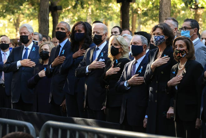 Former President Bill Clinton, former First Lady Hillary Clinton, former President Barack Obama, former First Lady Michelle Obama, President Joe Biden, First Lady Jill Biden, former New York City Mayor Michael Bloomberg, Bloomberg's partner Diana Taylor and Speaker of the House Nancy Pelosi (D-CA) stand for the national anthem during the annual 9/11 Commemoration Ceremony at the National 9/11 Memorial and Museum on September 11, 2021 in New York City.