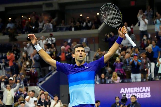Novak Djokovic celebrates after match point against Alexander Zverev in the U.S. Open semifinals.