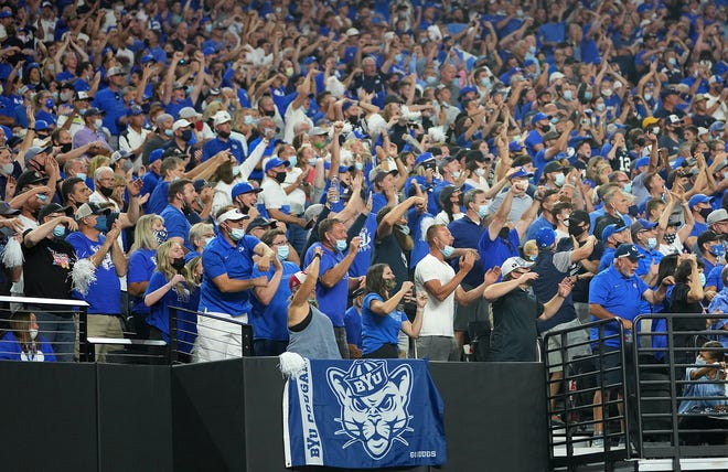 Brigham Young fans cheer during a game against Arizona at Allegiant Stadium.