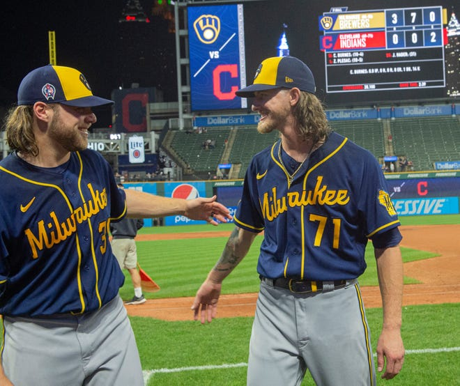 Milwaukee Brewers starter Corbin Burnes, left, and reliever Josh Hader celebrate after pitching a combined no-hitter in a 3-0 win against Cleveland on Sept. 11, 2021.