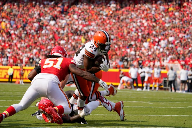Cleveland Browns running back Nick Chubb (24) scores past Kansas City Chiefs defensive end Mike Danna (51) during the first half of an NFL football game Sunday, Sept. 12, 2021, in Kansas City, Mo. (AP Photo/Ed Zurga)