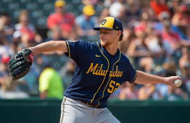 Milwaukee Brewers starting pitcher Eric Lauer delivers against Cleveland during the second inning of a baseball game in Cleveland, Sunday, Sept. 12, 2021. (AP Photo/Phil Long)
