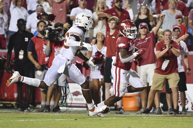Arkansas running back AJ Green slips past Texas safety B.J. Foster to score a touchdown during the second half of Saturday night's 40-21 Razorbacks victory in Fayetteville, Ark. The loss dropped the Longhorns to 1-1.