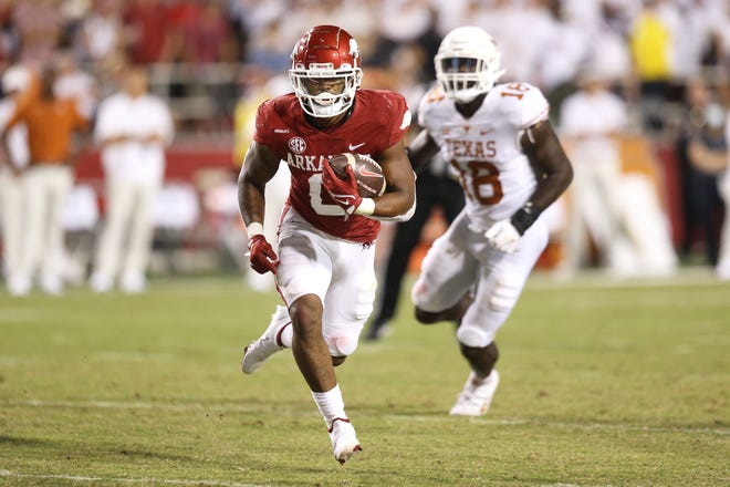 Arkansas running back A.J. Green runs for a touchdown to help seal the Razorbacks' dominant 40-21 win over Texas, which fell out of the AP top 25 poll.