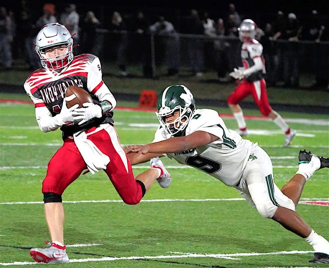 Sandy Valley's Mason Tucci hauls in a pass against Malvern earlier this season. Tucci has all seven touchdown catches for the Cardinals. He also has two defensive touchdowns.