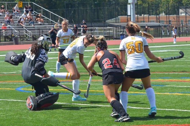 Moorestown senior Gigi Testa tries to redirect a shot against West Essex goalie Abby Zanelli