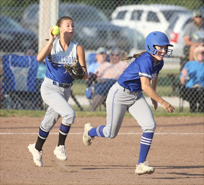 New Franklin third baseman Addy Salmon prepares to throw to shortstop Abby Maupin while Boonville's Alison Eichelberger races to second base during a rundown Thursday in New Franklin.