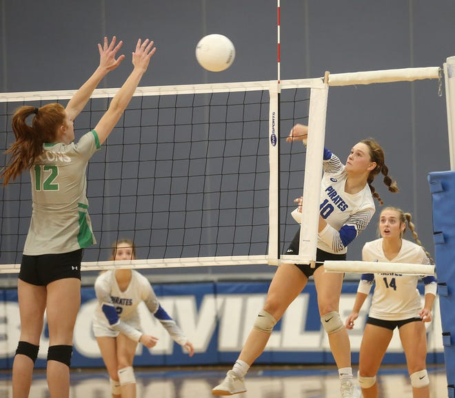 Boonville senior Nora Morris hits through a Blair Oaks block in the third set Thursday night in Tri-County Conference action at the high school gymnasium.