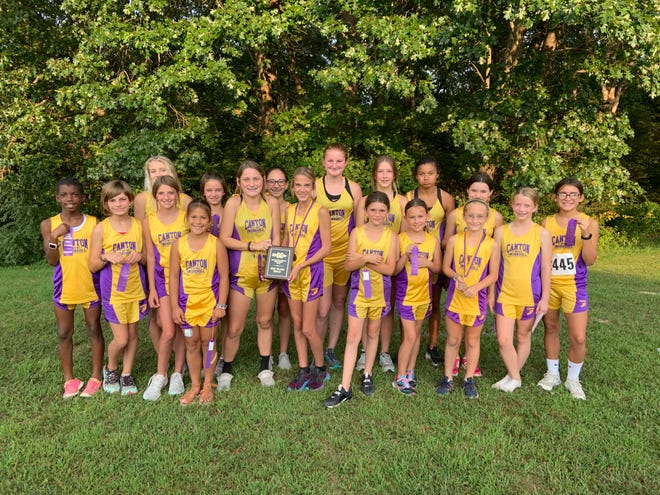 Pictured is the girls team displaying their secondplace plaque.