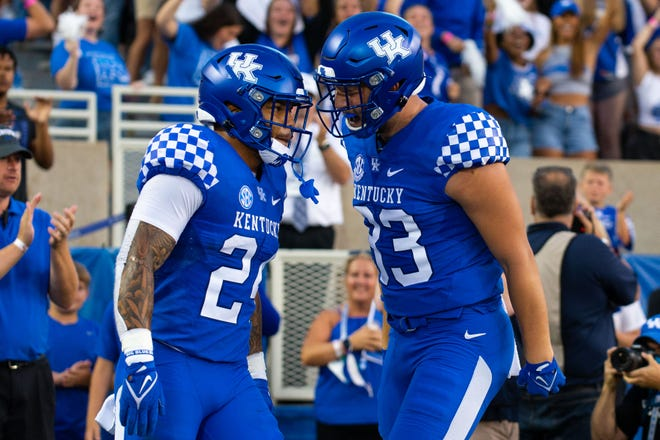 Sep 11, 2021; Lexington, Kentucky, USA; Kentucky Wildcats tight end Justin Rigg (83) and running back Chris Rodriguez Jr. (24) celebrate a touchdown scored by Rodriguez during the first quarter against the Missouri Tigers at Kroger Field. Mandatory Credit: Jordan Prather-USA TODAY Sports