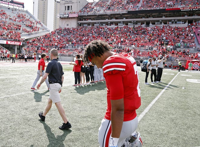 Ohio State Buckeyes quarterback C.J. Stroud walks off the field after throwing for 484 yards and three touchdowns in a 35-28 to Oregon Ducks.