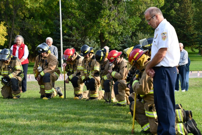 Crookston firefighters gather for a moment of silence during a private 9/11 ceremony held in honor of the 20th anniversary