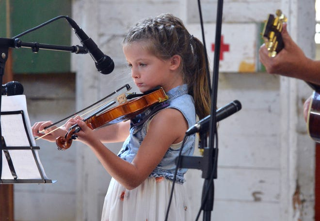 """8-year-old Tessa Underwood of Sterling performs """"Old Joe Clark"""" during Sunday's Fiddle Contest at the Wayne County Fair."""