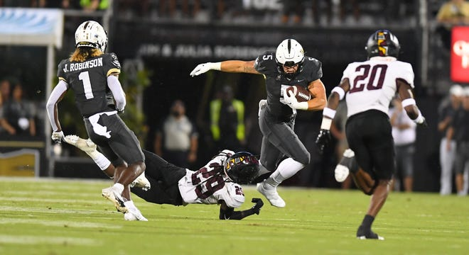 UCF's Isaiah Bowser (5) rushed for four touchdowns in the first half of a 63-14 win over Bethune-Cookman at the Bounce House on Saturday, Sept. 11, 2021.