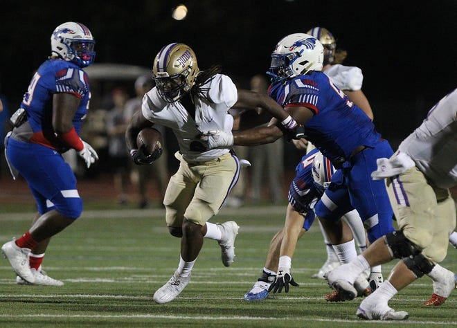 Butler's Kevontae McDonald (23) breaks free from the tackle of Hutchinson's Jaylon Bass (55) during their game Saturday night at Gowans Stadium. HCC lost to Butler 43-23.