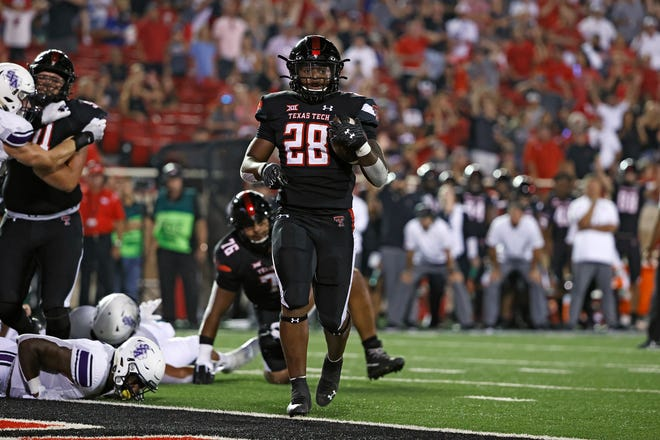 Texas Tech's Tahj Brooks (28) scores a touchdown during the second half of an NCAA college football game against Stephen F. Austin, Saturday, Sept. 11, 2021, in Lubbock, Texas. (AP Photo/Brad Tollefson)