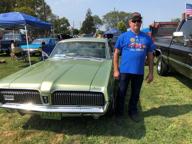 Ken Chapman of Belleville shows off his 1968 green Mercury Cougar at Wilson Park in Milan Saturday, surrounded by the Motorcycle Awareness and Suicide Prevention car show.