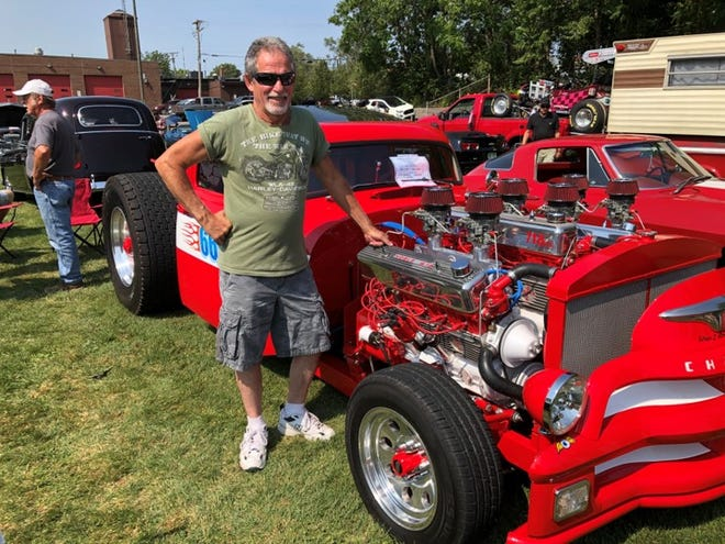 """Jim Noble of Azalia engineered this """"tricked out"""" three-engine 1954 pickup with drive tires off a semi truck.  """"It took me 15 years to get it all built,"""" he says."""