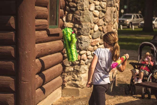 Children enjoyed breaking the piñata donated by Upper Minnesota River Valley Diversity Council.