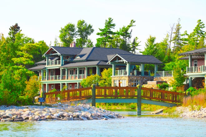 The DeVos' summer home on Lake Charlevoix. The Army Corps of Engineers approved dredging of the shoreline to create private boat access.  The bridge connects the mainland with the island created by the excavated land.