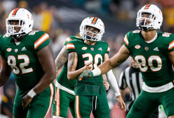 Hurricanes freshman place-kicker Andres Borregales (30) watches his field goal against the Appalachian State Mountaineers give the Hurricanes the lead during the fourth quarter at Hard Rock Stadium Saturday night.