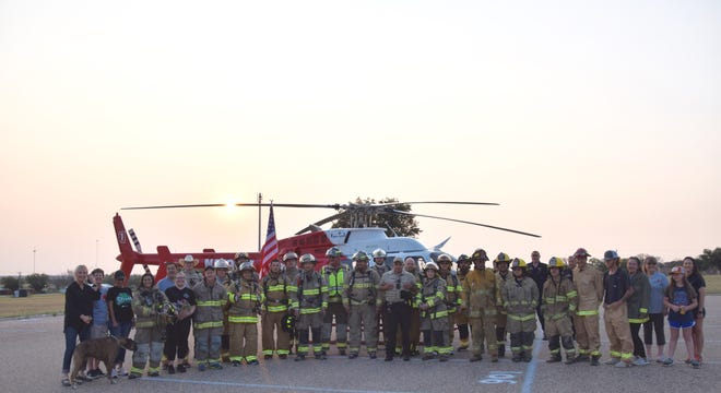 The firefighters, Shannon AirMed team, family members, EMTs, nurses, sheriff deputies and others that came together for the Runnels County 9/11 remembrance.
