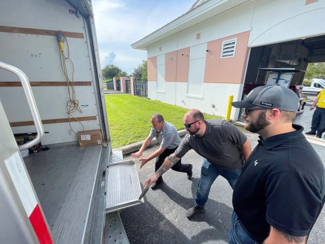 North Port Police officers and volunteers prepare to load a truck full of relief supplies bound for the Terrebonne Parish Sheriff's Office in southern Louisiana.